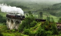 Travelling on a steam train in stormy and rainy weather