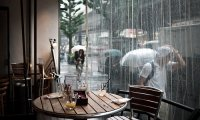 Relax at cafe during heavy rain with thunder outside