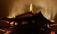 http://www.ambient-mixer.comPraying in the monastery beside lit torches on a windy night.