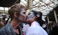 one zombie gives another zombie oral pleasure under the bleachers of a college sports game