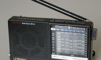 Sitting by a shortwave radio at night scanning for suspicious signals