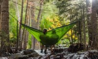 you put up a hammock with someone in the middle of the forest by a stream